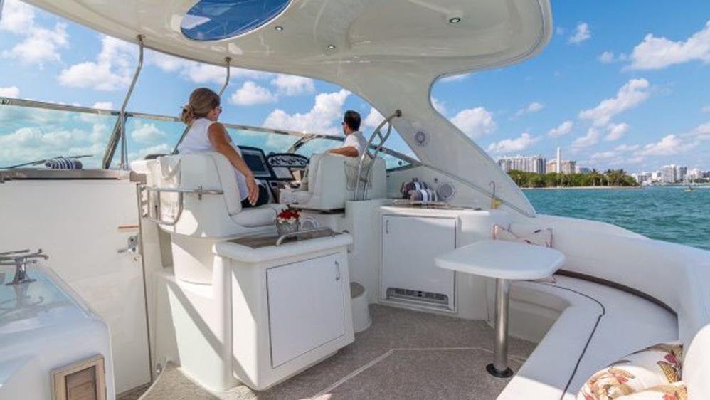 43' Cruiser Yacht Rental Miami Beach Aft Lounge and Helm