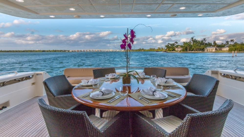 88' Ferretti Private Yacht Rental Miami Aft Deck Dining