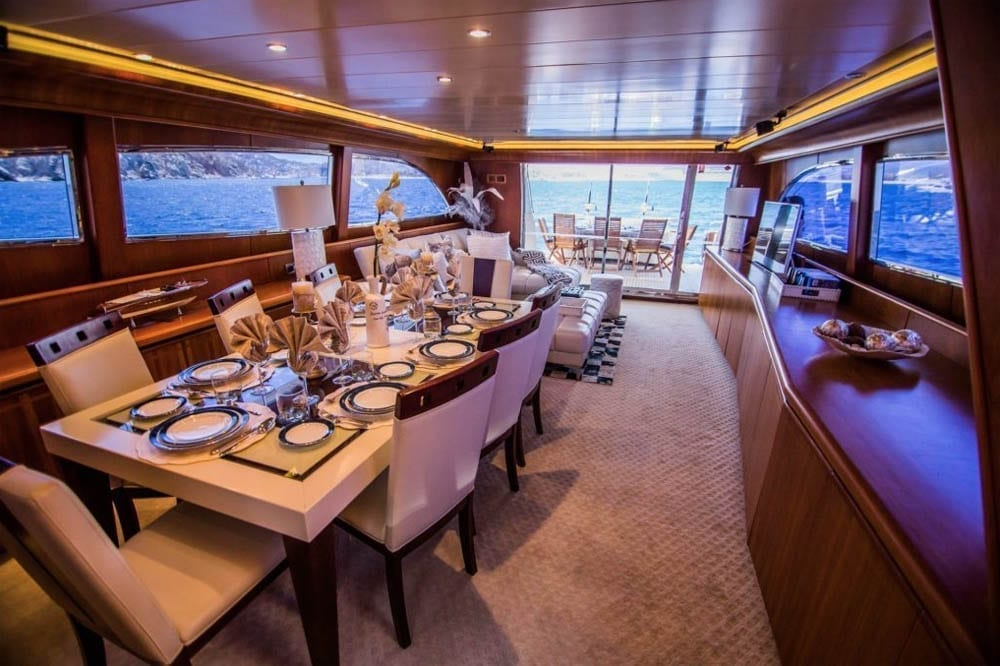 Cabo luxury yacht rental 93' Canados Salon Dining