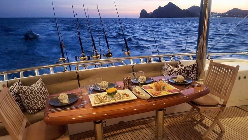 Cabo-San-Lucas-Yacht-Rentals-92-Horizon-Aft-Dining-Set