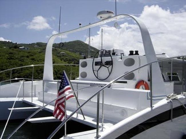Hawaii Yacht Rentals 64' Gold Coast Helm