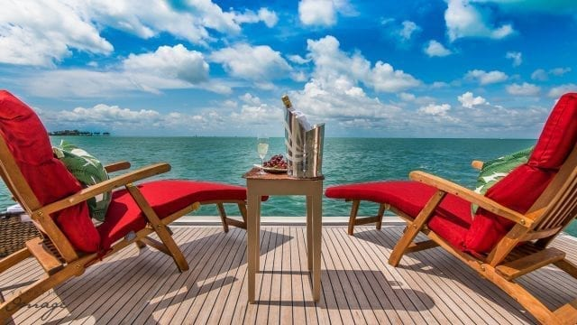 Miami Yacht Rentals 94' Ferretti Swim-step Sitting